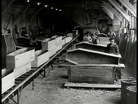 french workers hammering coffins coffin production line factory ws workers moving coffins boards bg ws workers stacking coffins from flatbed shelves... - 1946 stock videos and b-roll footage