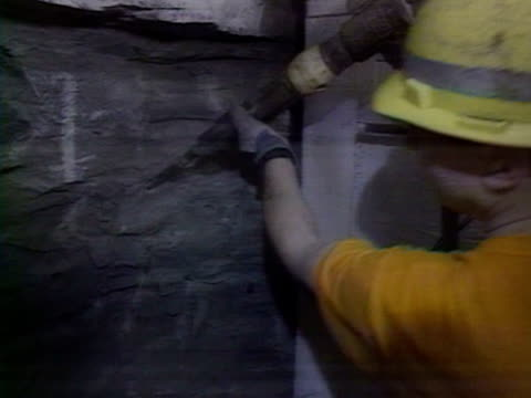 stockvideo's en b-roll-footage met french workmen philippe cozette shakes hands with british worker robert fagg as the final section of rock is drilled through and the french and uk... - het kanaal