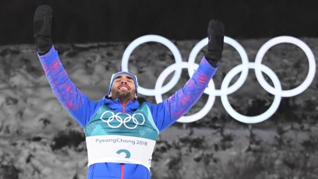 frenchman martin fourcade writes himself into the history books with a second biathlon gold at the pyeongchang olympics snatching victory by a... - nordic skiing event stock videos and b-roll footage