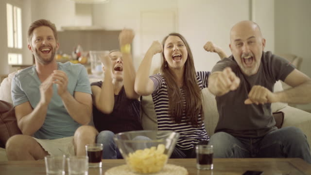 frenetic fans in front of tv - vier personen stock-videos und b-roll-filmmaterial