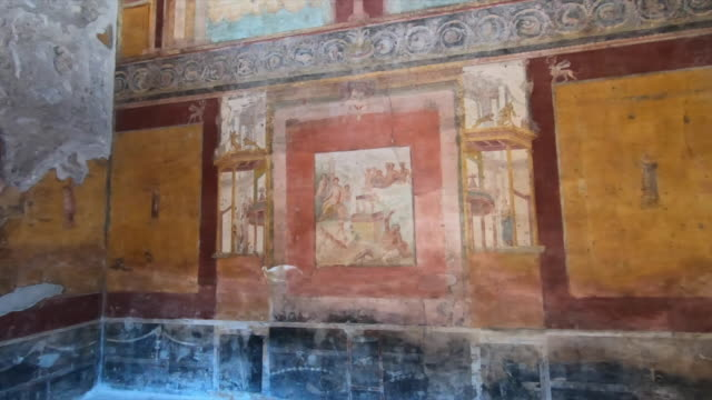 fresco art in the plaster of ancient ruins sightseeing historic landmark of pompeii, italy, europe. - slow motion - gammal ruin bildbanksvideor och videomaterial från bakom kulisserna