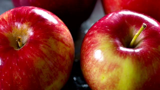 fresh apple close up - apple fruit stock videos and b-roll footage