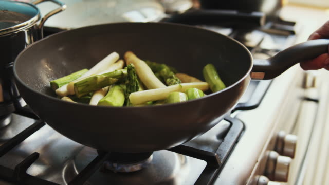 fresh asparagus cooking. - asparagus stock videos & royalty-free footage