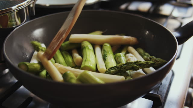 fresh asparagus cooking with gasstove. - asparagus stock videos & royalty-free footage