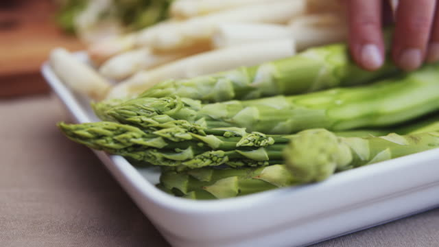 fresh asparagus ready for cooking. - asparagus stock videos & royalty-free footage