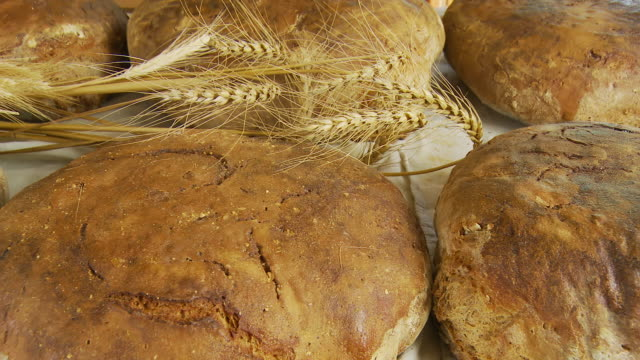 hd dolly: fresh baked bread with wheat crop - peasant bread stock videos and b-roll footage