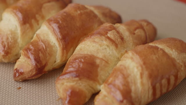 fresh baked croissant on the baking tray - cream cake stock videos & royalty-free footage