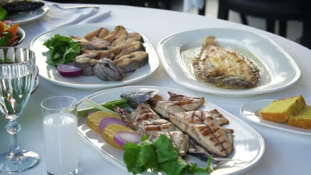 fresh baked fish on a plate - mediterranean food stock videos & royalty-free footage
