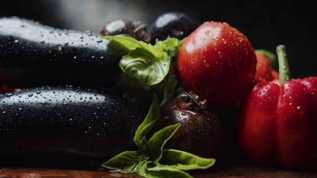 fresh bell peppers, eggplants and tomatoes close-up - aubergine stock videos & royalty-free footage
