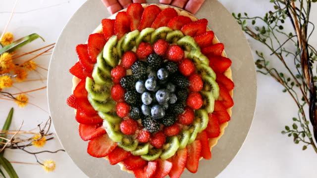 fresh berry tart on cake stand display - tart dessert stock videos & royalty-free footage