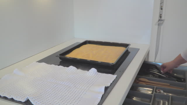 fresh biscuit in baking tray - baking tray stock videos & royalty-free footage