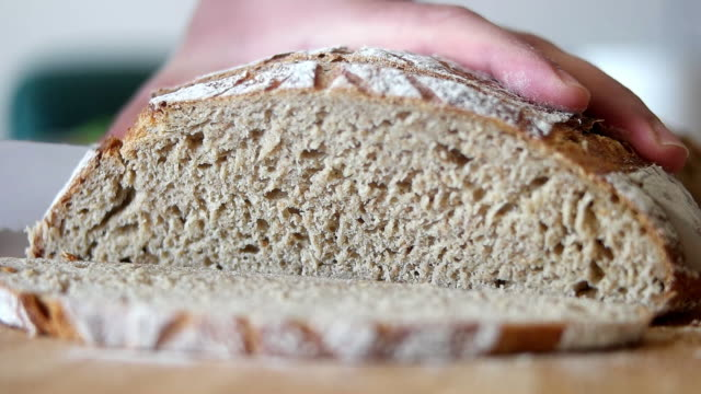fresh bread loaf cut into slices - wholegrain stock videos & royalty-free footage