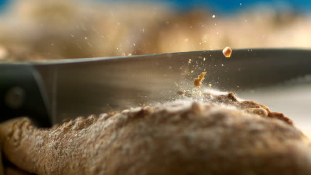 fresh bread loaf cut into slices - macro stock videos and b-roll footage