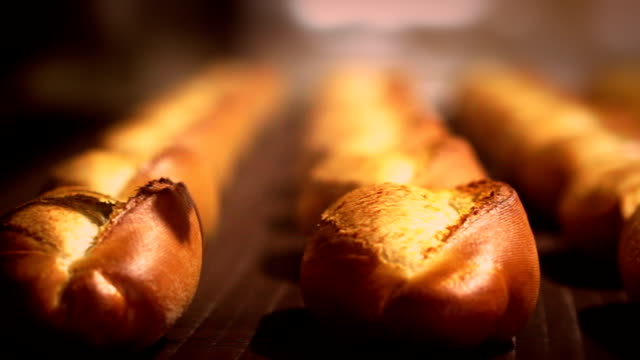 fresh bread on the conveyor belt - bakery stock videos and b-roll footage
