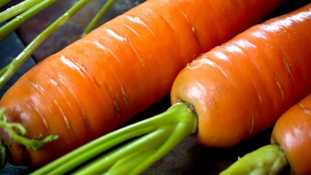 fresh carrot close up - carrot stock videos and b-roll footage