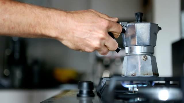 Fresh coffee brewing in a mocha pot