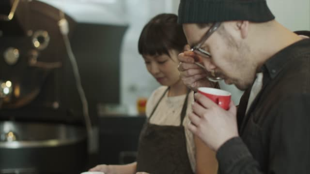 Fresh coffee cupping and tasting (slow motion)