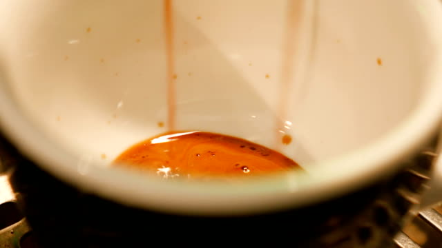 fresh coffee pouring into the cup - coffee drink stock videos & royalty-free footage