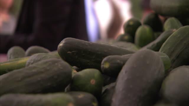fresh cucumbers fill bins at a farmer's market. - cucumber stock videos & royalty-free footage