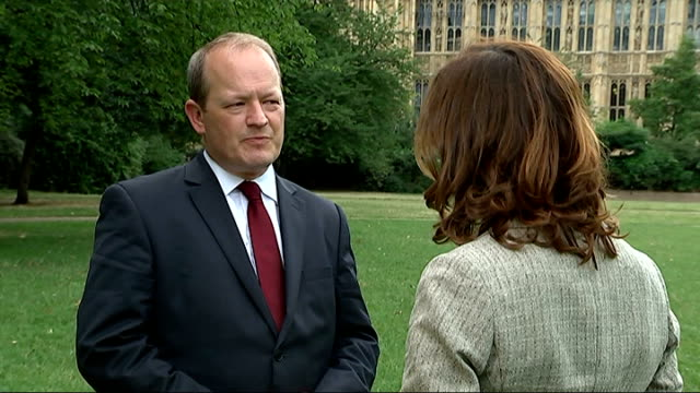 fresh evidence of coverup of sexual abuse against young boys by cyril smith london ext simon danczuk mp setup shot with reporter / interview sot - mp stock-videos und b-roll-filmmaterial