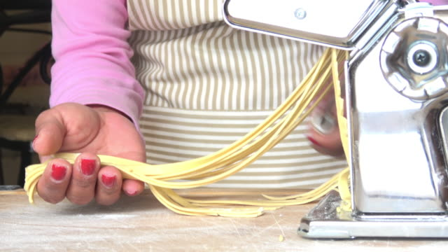 fresh fettuccine from pasta machine - pasta machine stock videos and b-roll footage