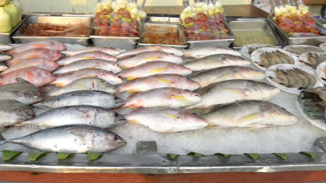 Fresh fish and seafood on ice for barbecue