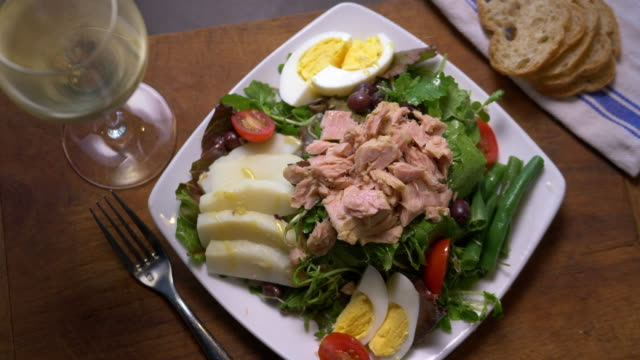 a fresh, french nicoise salad - pan across. - french food stock videos & royalty-free footage