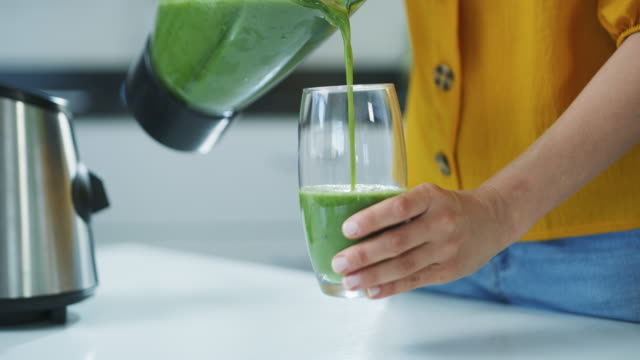 fresh from the blender! - smoothie stock videos & royalty-free footage