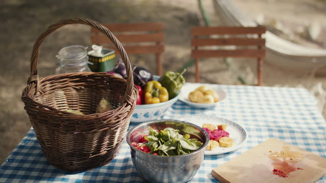 fresh fruit and vegetables on table in sun - group of objects stock videos & royalty-free footage