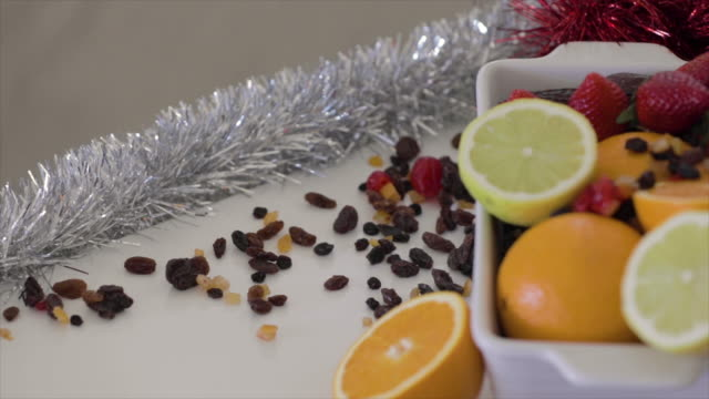 fresh fruit - oranges and lemons being prepared for xmas - fruit bowl stock videos & royalty-free footage