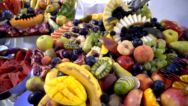 fresh fruit served on buffet table - fruit stock videos & royalty-free footage