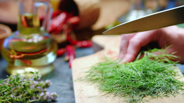 fresh green dill chopping - dill stock videos and b-roll footage