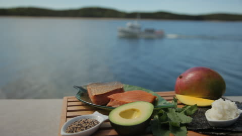 fresh ingredients for sushi with boat in background - mango fruit stock videos & royalty-free footage