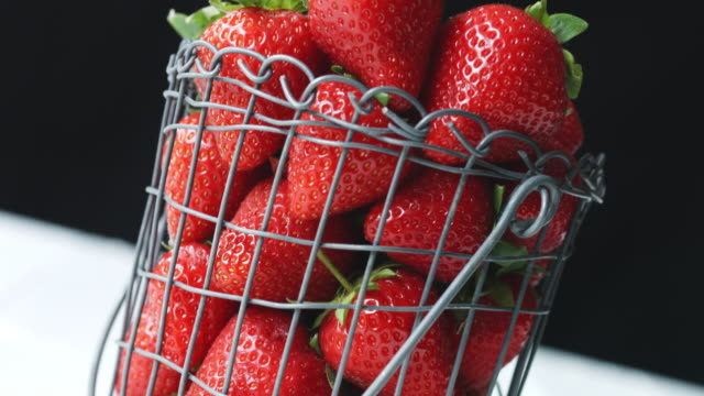 fresh, juicy strawberries in wire basket at a jaunty angle - juicy stock videos & royalty-free footage
