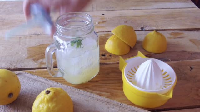 fresh lemonade with ice - traditional lemonade stock videos & royalty-free footage