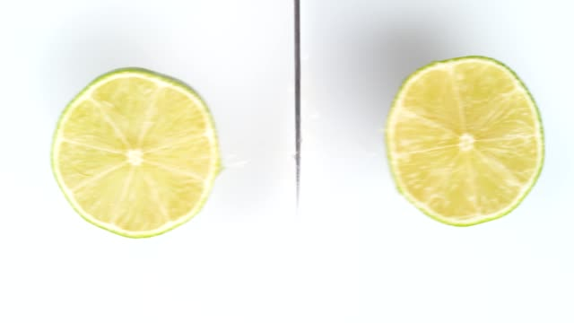 fresh lime cut. studio beauty shot. - lime stock videos & royalty-free footage