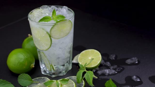 fresh lime soda in glass drink - fizzy lemonade stock videos & royalty-free footage