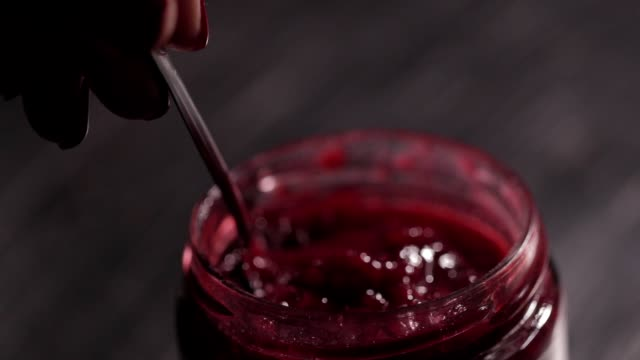 fresh made raspberry jam,taking a spoon of jam - raspberry stock videos and b-roll footage