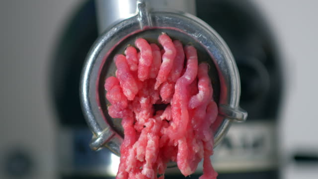 fresh meat coming 0ut of a mincer - meat stock videos & royalty-free footage
