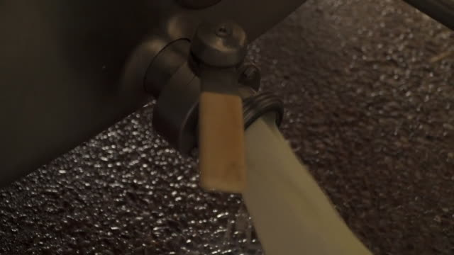 fresh milk from cows being poured down drain at dairy farm as supply for milk dries up as the uk remains on lockdown due to coronavirus crisis - pouring stock videos & royalty-free footage