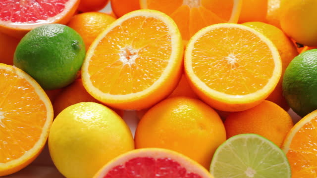 cu fresh oranges and lime / london, united kingdom - inquadratura dall'alto di un tavolo video stock e b–roll