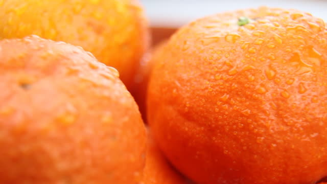 fresh oranges - loopable, hd - tangerine stock videos and b-roll footage