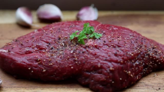 fresh organic steak on wooden cutting board with salt, pepper and garlic - ketogenic diet stock videos & royalty-free footage