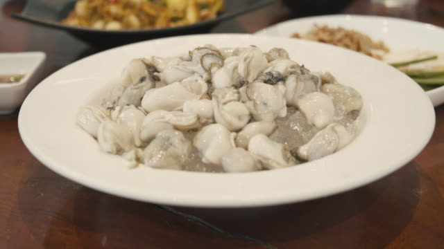 fresh oyster on ice - wood plate stock videos & royalty-free footage