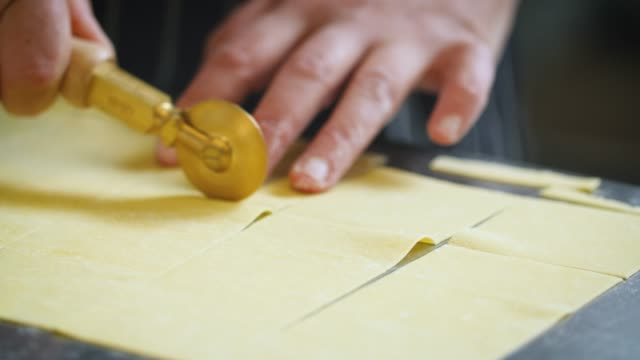 fresh pasta sheet cut into squares - square stock videos & royalty-free footage