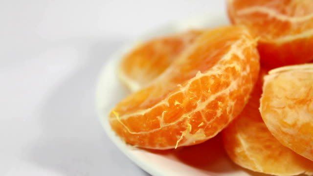 fresh peeled oranges. - tangerine stock videos and b-roll footage