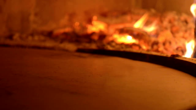 fresh pizza baking inside wood fire oven - pizza oven stock videos and b-roll footage
