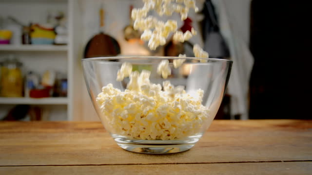 Fresh Popcorn Falling Into Bowl
