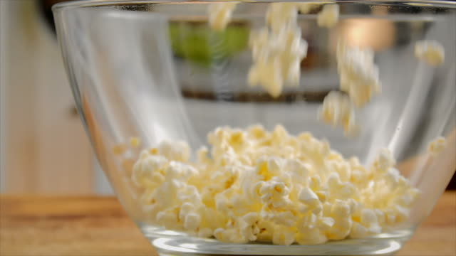 fresh popcorn falling into bowl - bowl stock videos & royalty-free footage