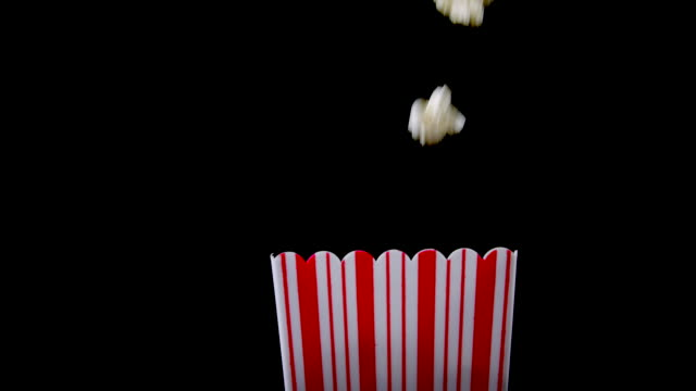 fresh popcorn falling into box - popcorn stock videos & royalty-free footage